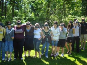 Myself and classmates lined up for a trust walk on a retreat our graduating year.